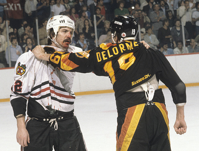 Grant Mulvey and Ron Delorme take a rest after brawling during a 1982 Canucks-Blackhawks game. (Tony Tomsic/SI) HACKEL: Power struggle could cost the NHL its season