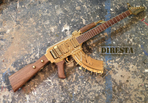 laughingsquid:  AK-47 Assault Rifle Turned Into a Functional Golden Guitar  Awesome, very nice.