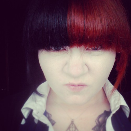 Dyed my hair a darker shade of red & re-did the black so no more roots ^_^ Don't know why I like this photo, think it's cos I look evil.