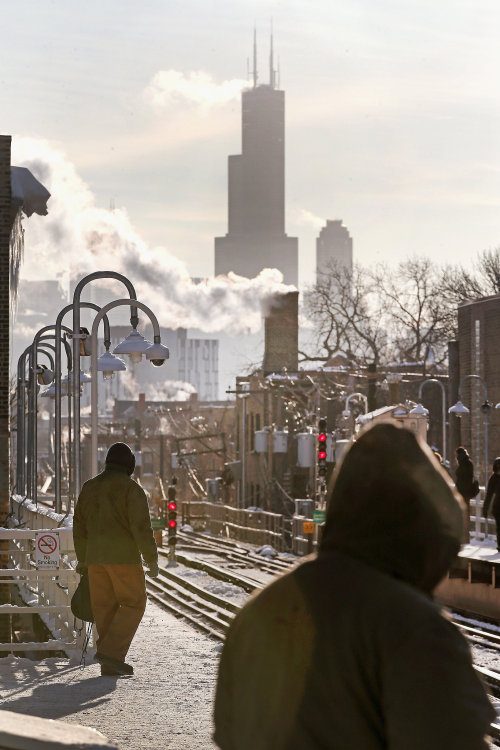 Chilly passengers waited for the L train in Chicago. Getty / Scott Olson (via Freezing Temperatures in Chicago 2014 | Pictures)