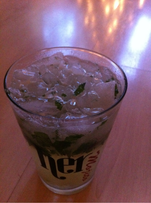 24th December 2012  Naughty.  I'm feeling very naughty.  Mojito at 4pm on a WEEKDAY :)  Managed to survive the drop-in session this morning with 16 volunteers in the building - lovely peeps for coming out on Christmas Eve so that we could open for those who will be having a difficult time over the festive period.  Just about to say to goodbye to my boys who are off to their Dad's for the next couple of days.  Which is sad. Coz this is the first Christmas without them :(  #qsmypictoday