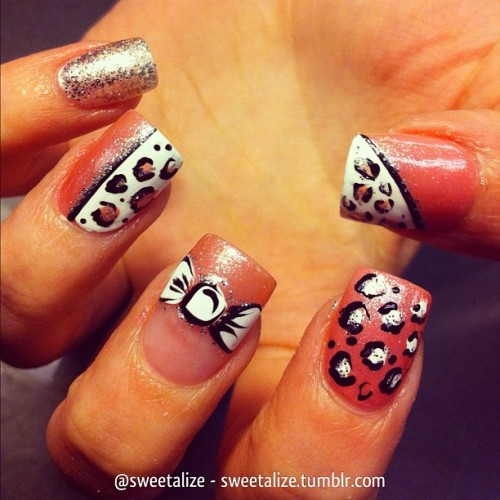 Another slight variation of a popular design over acrylic nails on @jordan_lynn77 ☺ #acrylicnails #gelnails #hawaiianorchid #princessrules #opi #bow #glitter #pink #leopard #leopardprint #cheetah #cheetahprint #animalprint