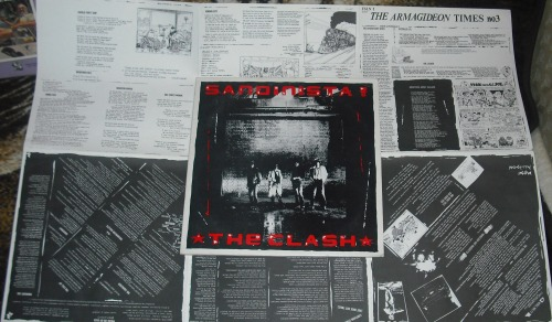 The Clash - Sandinista!, with its rather unwieldy lyric sheet.  (Bonus kudos to The Clash for covering Mose Allison.)