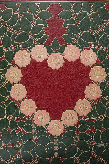 heaveninawildflower:  Art nouveau binding: Detail by Kungliga biblioteket on Flickr. Leather binding with mosaics and gold tooling in a romantic art nouveau composition. The binding is by royal bookbinder Gustaf Hedberg (1859-1920), and was executed around 1900.
