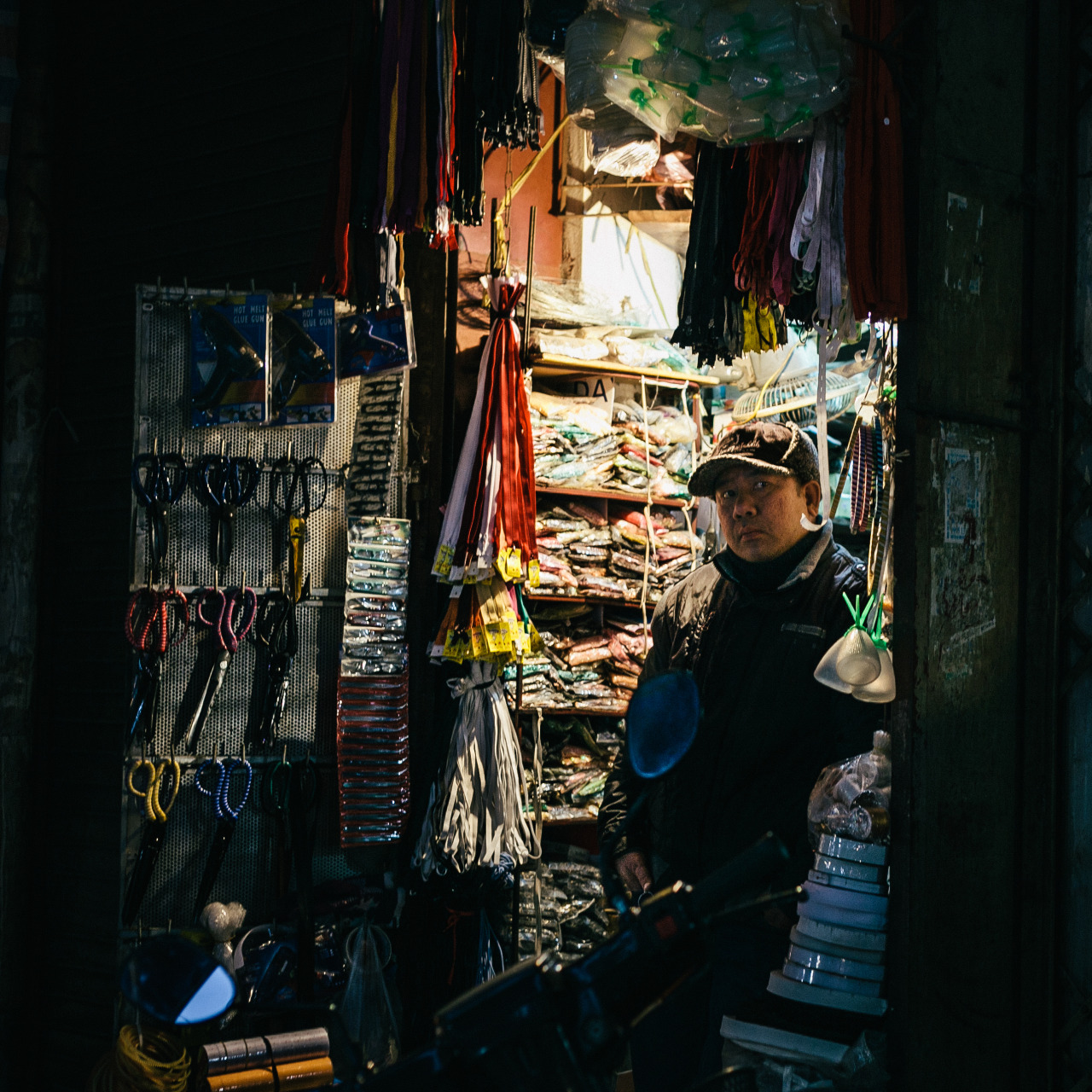 Silence A seller stays silent at his shop's front door in the end of the day Hanoi, Vietnam My Flickr | My works
