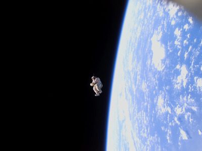 kaiyves:  spacewatching:  A space suit floats freely away from the International Space Station in a scene reminiscent of a sci-fi movie. But this time, no investigation is needed. The suit is actually the world's latest satellite and was launched on Feb. 3, 2006. Dubbed SuitSat-1, the unneeded Russian Orlan spacesuit filled mostly with old clothes was fitted with a radio transmitter and released to orbit the Earth.  Wild!  Wow.