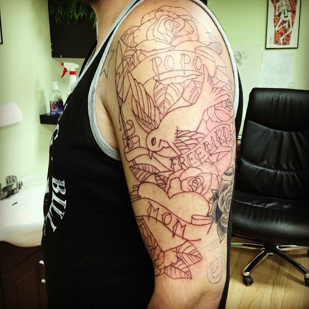 Start of a half sleeve on @_brp ! Can't wait for the shading! #tattoo #halfsleeve #linework #sparrow #rose #momtattoo