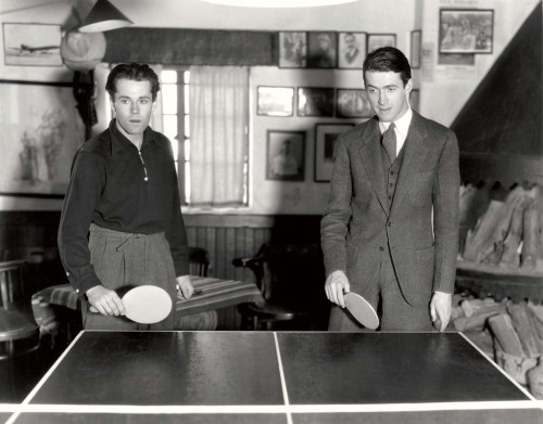 Henry Fonda and James Stewart prepare to ping pong, 1937