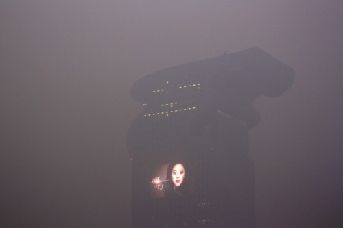 CHOKED UP  Haze obscured the Pangu Plaza Office Building in Beijing Saturday. The city has issued its first-ever 'orange' fog warning, an alert to the elderly, children and people suffering from respiratory disease to stay indoors and limit exposure to the pollution. (Photo: ChinaFotoPress / Zuma Press via The Wall Street Journal) It doesn't get more Blade Runner than this.
