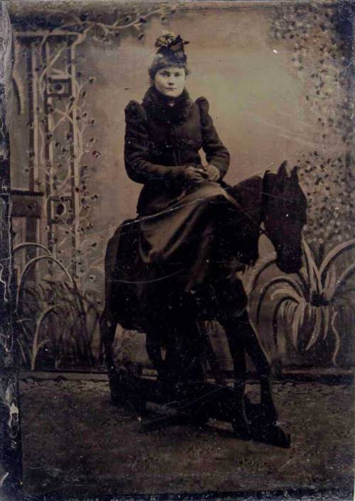 ca. 1880-1900's, [tintype portrait of a woman on a prop studio horse] via Jeffery Kraus Antique Photographics, Tintype Collection