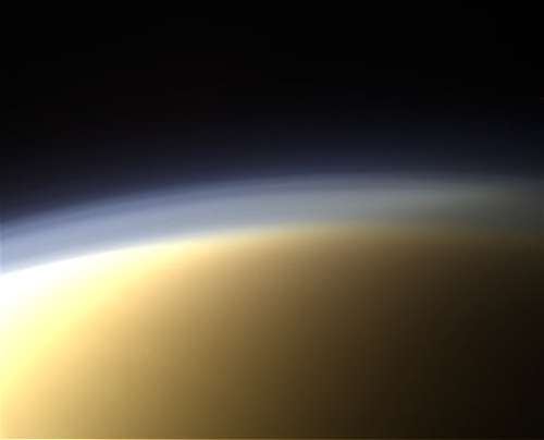 Up Close and Personal With Titan's Haze      This is an approximate true color image of Titan's haze layers, taken by Cassini's Imaging Science Subsystem during Cassini's 91st encounter with Titan on April 5, 2013.      Image: NASA / JPL / SSI / composite by Val Klavans      Titan's upper haze layers appear blue, while its main atmospheric haze appear orange in this view. The difference in color is most likely due to particle size rather than composition. The blue haze probably consists of smaller particles than the orange haze.