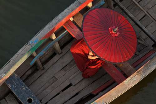 allasianflavours:  Young monk with his parasol in a traditional Burmese long tail boat by yipe