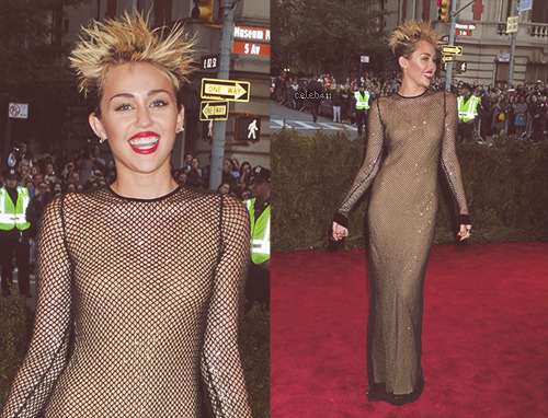 Miley Cyrus at the 2013 Met Gala held at the Metropolitan Museum of Art in New York City.  you look like a goon