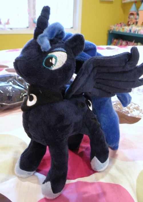 "ponytoday:  What: Luna plush Where: kickstarter (limited run) Price: $40 6 months ago I placed a 'donation' of $40 to the kickstarter that promised ""moon plushies for the masses!"" and they arrived today. The creator/project manager made several severe underestimates in his timeline, so it took quite awhile for these to get here, but there was never any doubt in my mind that I would indeed get them. November the project was launched; claiming to be a ""moon plush inspired by sailor moon"" it was quickly funded. Hasbro contacted the creator and asked him to remove the listing, because some tshirt images were copyrighted hasbro images. Several corrections were made to the plush. A final prototype was decided, and manufacturing began. Shipping was delayed because of Chinese New Year, and then further delayed with customs held the shipment for inspection. Now they are finally arriving! Luna is exactly what I expected; I had been following the plush updates and knew what to expect. She's super soft, and I love her wired wings! the stuffing is a little weird in her legs, but with some rearranging should be fine. I got 2! Not sure if I'll keep both, or maybe….?   She´s so cute!! :D I´d love to have one. *_*"