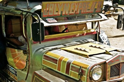 """The jeepney is a real Philippine icon. The originals were converted military jeeps abandoned by the US army after WWII. By today's standards this one is pretty tame but to me the older beat up ones are the most visually interesting, they have this slightly dystopian appearance that wouldn't look out of place in a post apocalyptic road movie."" - Flickr user AdamJamesWilson (via Photo Of The Day: Philippines Jeepney 