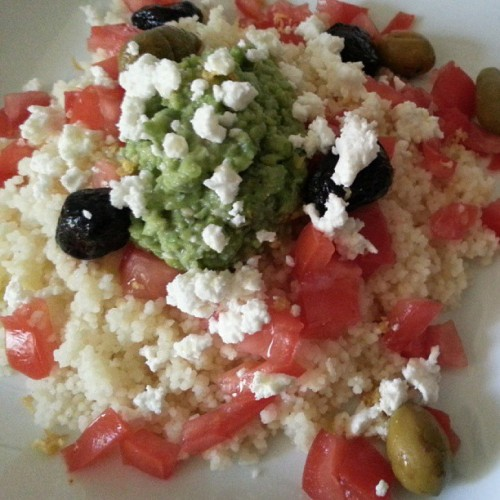 Deeming it too hot to cook…smashed Fava beans, tomatoes, olives, feta, and lemon zest over cous cous.