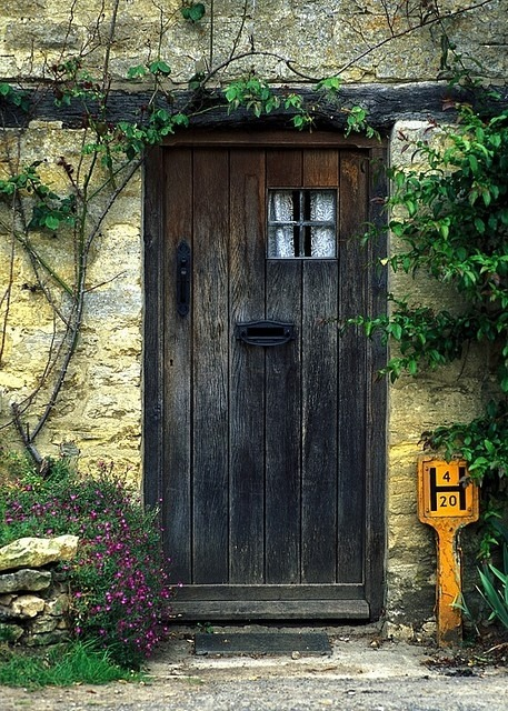 sweetlysurreal:  A cottage door in the town of Bibury located in the English Cotswolds region. via Flickr