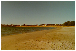 Another beachphoto. This is one of the beaches in my hometown.One of my best friends growing up, lived on one of those farms in the background, so we would spend so much time playing here. It's a great place.