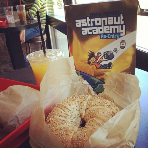 New book goes out for a celebratory bagel. #astronautacademyday