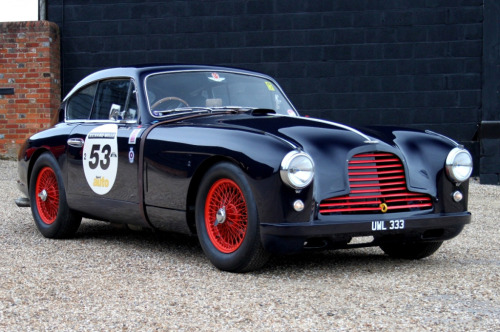 archaictires:  1953 Aston Martin DB2/4 Mk1 I like the red details, goes well with the dark blue.