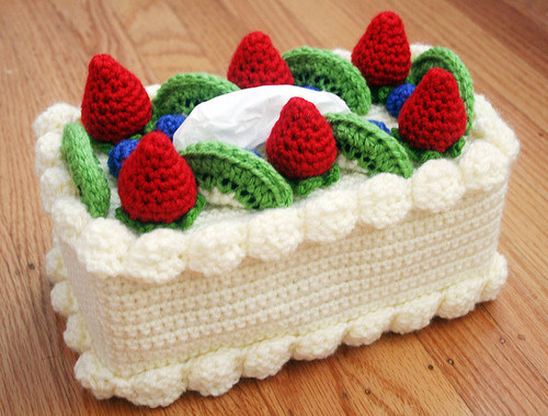 crankycrafter:  DIY Granny Crafting Crochet Tissue Box. This would look right at home at the church holiday bazaar with the crochet bottle dolls. http://www.michaels.com/Chiffon-Cake-with-Fruit-Topping-Tissue-Box-Cozy-%28Crochet%29/34539,default,pd.html  Is this granny crafting or just a bad idea from Michaels craft store?    truebluemeandyou: cute, kitschy, I NEED THIS, or not in my house?