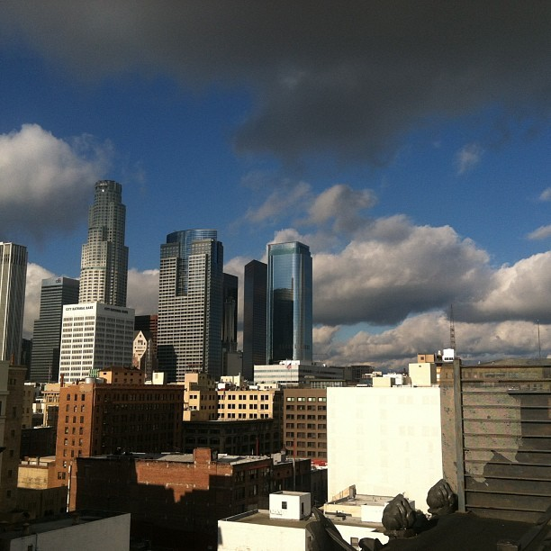 Unreal reality. #dtla #rooftop #home #sky #clouds #rainyday #christmaseve