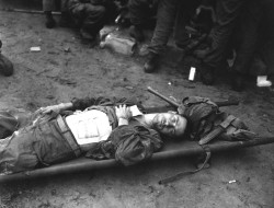 Pfc. Conlon Waiting on Medical Aid, 1950Pfc. Thomas Conlon, 21st Infantry Regiment, lies on a stretcher at a medical aid station on September 19, 1950.