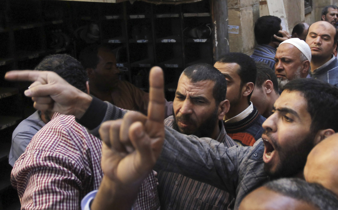 "Tens of thousands of Egyptian protesters surged around the presidential palace on Friday and the opposition rejected President Mohamed Mursi's call for dialogue to end a crisis that has polarized the nation and sparked deadly clashes. The Islamist leader's deputy said he could delay a December 15 referendum on a constitution that liberals opposed, although the concession only partly meets a list of opposition demands that include scrapping a decree that expanded Mursi's powers. ""The people want the downfall of the regime"" and ""Leave, leave,"" crowds chanted after bursting through barbed wire barricades and climbing on tanks guarding the palace of Egypt's first freely elected president. READ ON: Protesters surge around Egypt's presidential palace"