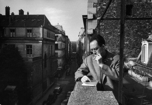 French writer Albert Camus smokes a cigarette on the balcony outside his friend and publisher Michel Gallimard's office in Paris, 1955. Camus won the Nobel in 1957; in 1960, when he was 46 years old, he was killed in a car crash along with Gallimard, who was driving. http://life.time.com/culture/nobel-prize-winners-photos/attachment/04_01020837/