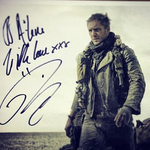 This autographed still is the outside world's first look at Tom Hardy as Mad Max This photo was uploaded to the internet by Dexter Rose and was later confirmed as real by Warner Bros. So there you are. Can't fucking wait.