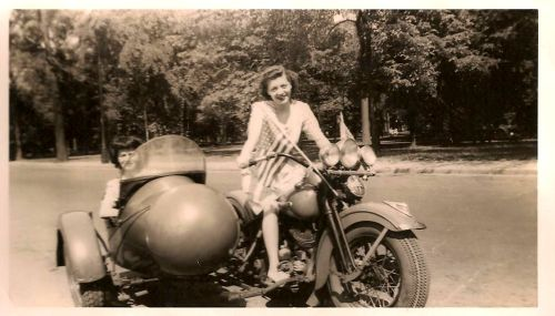 Double motolady action- 1940's throwback. [ more tagged vintage | sidecar ]