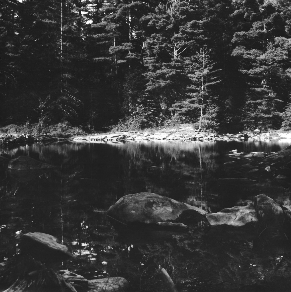 Still waters- 2013 Gelatin silver print scan. I took this photo last summer while on vacation in the Adirondacks and just made this print this passed Monday. Still have some tweaking to do on it to bring out more of a tonal range in the trees and rocks but it's getting there!  View high-res here Tumblr | Facebook | Behance