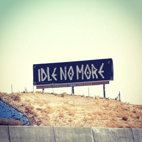 "fragua:  I liberated this billboard. It was a damn cold winter night in the desert but the moon stared down at me condescendingly and said ""Are you gonna fucking do this?!"" I just thought ""Idle No More"" & ""get your ass out tha car!"" Long story short, I ended up with cactus in my knee cause the moon didn't feel like lighting my way and another billboard on the notch. (at I-25, Bernalillo, NM)  Bigups!"