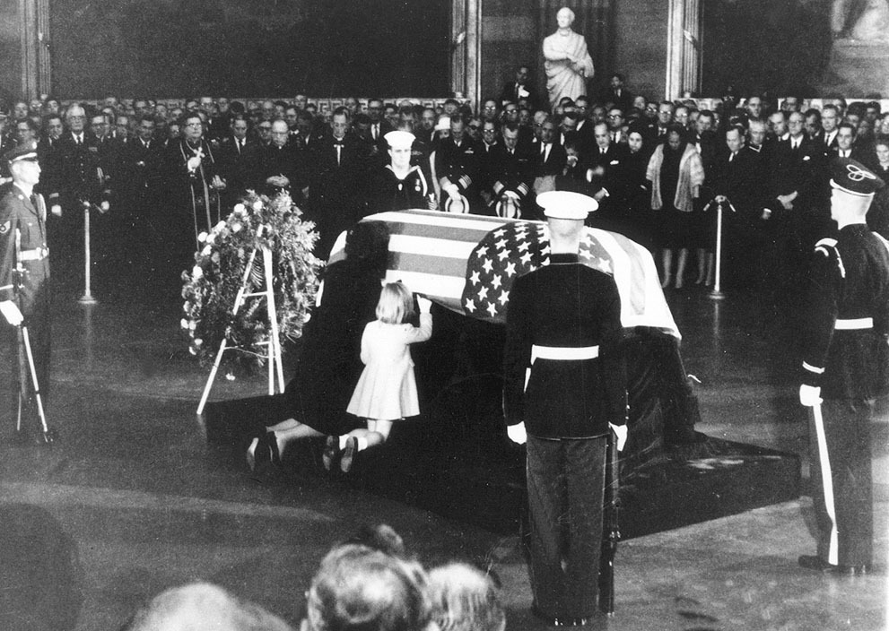 collectivehistory:  Jackie Kennedy kisses the casket of her late husband, President John F. Kennedy while her daughter Caroline touches it in rotunda of U.S Capitol, on November 24, 1963. (AP Photo)