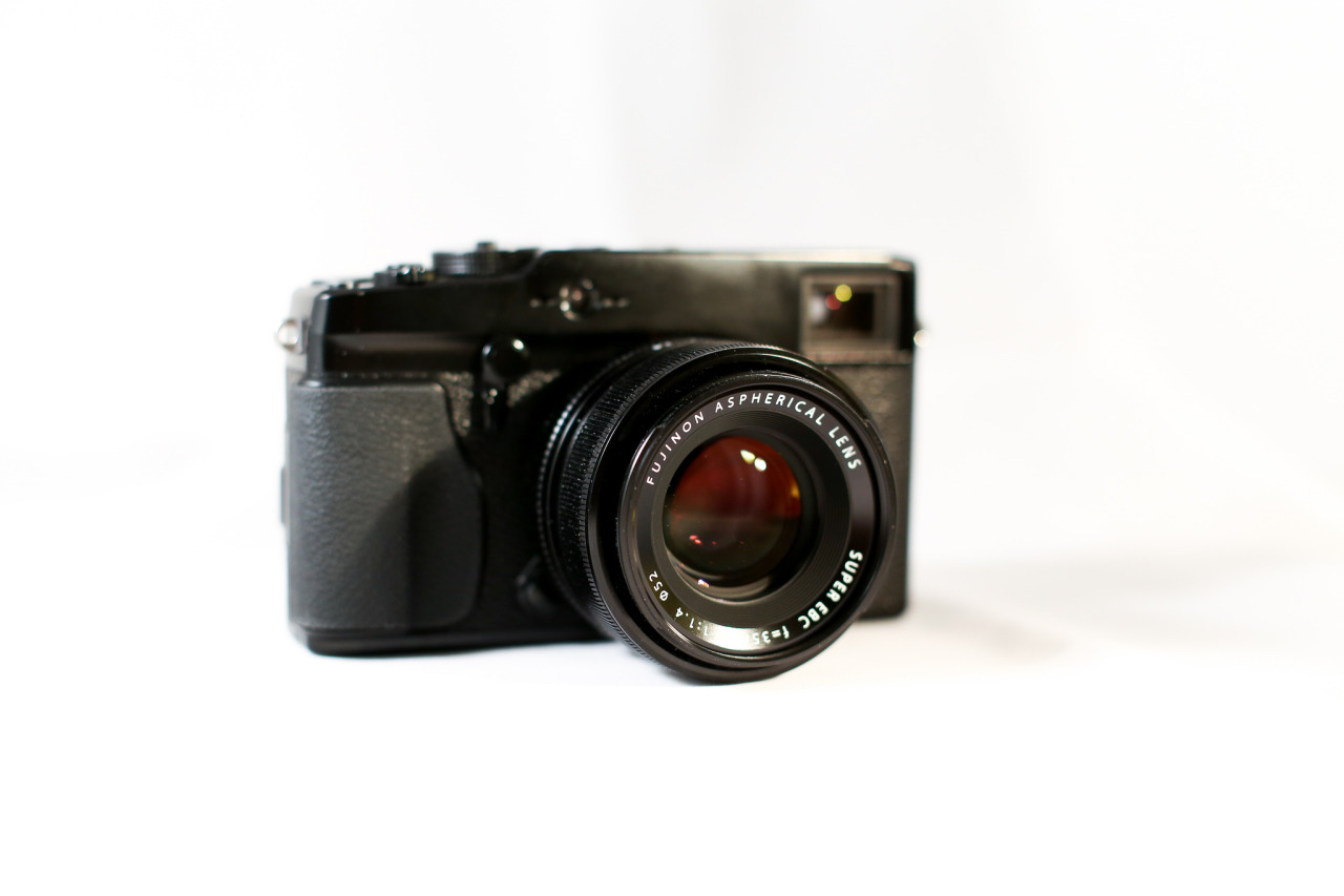 Fujifilm X-Pro 1 on Flickr.  I ordered a mini tabletop photo studio with a couple of lights. Any advice on best positioning of the lights?