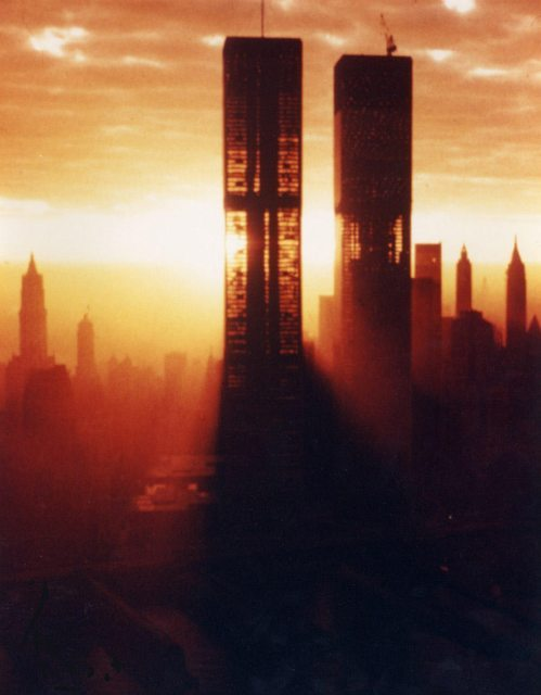 "an eery photo during the construction of the world trade towers that i wanted to post in a ""celebrities without makeup"" fashion. behind a thin vail of glass and aluminum, skyscrapers are slender central cores surrounded by ""makeup."""