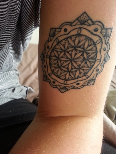 This is my first tattoo, it's a mandala (flower of life) on my left arm. It has spiritual meaning behind it. It was done by toon who owns his own business and his work is astounding.