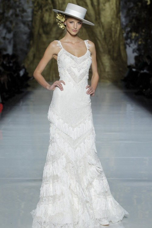 womensweardaily:   A look from the Pronovias Spring 2014 preview show in Barcelona.  Photo by Courtesy of Pronovias