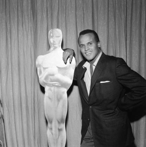 Harry Belafonte leans against an Oscar statue at the Academy Awards on March 27, 1956. I was going to wait until Oscar night to post this one but… Photo: Archive Photos/Getty Images.