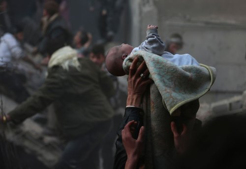 laralitah:  khaste-irooni:  Men hold up a baby saved from a pile of rubble. Damascus, Syria, 2014  precious, life is