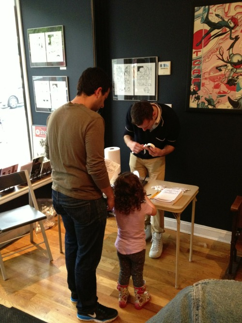 The first Bean Dog puppet is born with a little assistance from helper Matt!