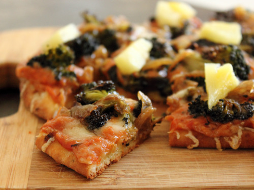 flatbread pizza with roasted veggies, caramelized onions, and pineapple.