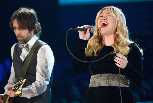"coupleoflines:  The flawless Kelly Clarkson used her Grammy time by performing a gorgeous tribute to Patti Page with a cover of her song ""Tennessee Waltz."" This performance then turned into a homage to great Carole King with a cover of her hit ""(You Make Me Feel Like) A Natural Woman."" Watch:  Kelly Clarkson has the best voice in the industry right now. Amazing."