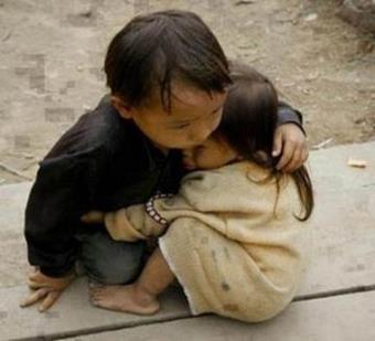 A young muslim child, no more than five years old, embracing his younger sister after the buddhists have slaughtered their entire family; would the ethnic cleansing in Borma ever stop?  Could he shield her terrified heart from the terrors her eyes witnessed?  What a five years old can possibly do?  But USA and their allies can't benefitfrom defending the muslims minority in Borma; there's no Oil there, certainly Borma is of no strategic significanceat all,and the Muslims there didn't demandimplementationof Shari'a Law as Mali for example; and there are no Mujahideen (so calledterrorists) in Maynmar.  So why would the UN interfere?  why would the Security Council take any action tostop theethniccleansing against Muslims?  Dear muslim child; i've failed you, the entire Ummah did except the Mujahideen, but Allah shall not fail you.