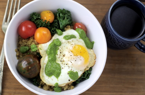 Sunny Side Up Egg with Quinoa, Sauteed Kale, Tomato and Basil & Scallion PureeIt's a slow rainy Saturday in New York.1 egg1/2 cup dry Quinoa1 cup Low Sodium Vegetable Stock1 cup chopped Kale, large stems removed1/4 cup Baby Heirloom Tomatoes2 generous handfuls of fresh Basil1/2 cup chopped Scallions1 clove Garlic4-5 Tbsp Olive Oil1/4 cup White Wine Vinegar1 Tbsp ButterSalt & Pepper to tasteIn a saucepan 1/2 cup of water and 1 cup Vegetable Broth to a boil.  Add quinoa and season with a bit of salt.  Cover and bring down to a simmer until the liquid cooks off (about 15 minutes).  In a saute pan, saute minced garlic in a bit of olive oil until soft.  Add the cooked quinoa and toss.  Cook on low heat, continuing to cook off any remaining liquid in the quinoa.  In a blender, liquify basil, scallion and a 2-3 tablespoons of olive oil.  With the blender going, slowly stream in the white wine vinegar, which will thicken the puree.  In a saute pan, saute the kale and tomato in a bit of olive oil until soft.  Add to quinoa and toss.  Season with salt & pepper.  In a saute pan, melt butter over low-medium heat.  Crack the egg into the pan and season with salt and pepper.  Cover with a lid until the whites have firmed up.  Serve quinoa in a bowl, top with the sunny side up egg and spoon some of the basil & scallion puree over the top.  Serve immediately.