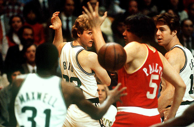 Larry Bird tosses a no-look pass to Cedric Maxwell during a 1980 game against the Rockets. (Walter Iooss Jr./SI) GALLERY: Rare Photos of Larry Bird