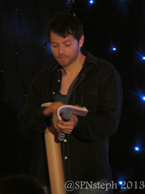 Misha auctioning off a script and signed poster