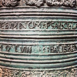 bell inscription. Košica, SK (at the road)
