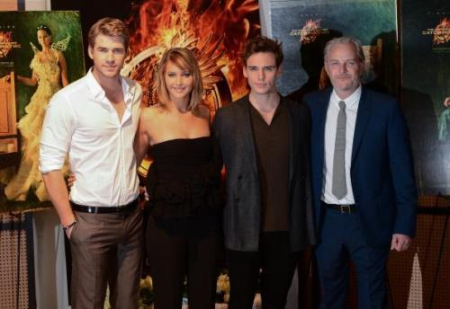 GORGEOUS photos of the CATCHING FIRE cast with director Francis Lawrence at the 2013 Cannes Film Festival. See more HERE!
