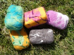 Felted Soaps.   Fab to take into the shower.   Slightly exfoliating, they stop the soap from becoming slimy on the sink.   The flt shrinks with the soap. B. Available from VixCrafts on Facebook. Or www.etsy.com/shop/vixcrafts